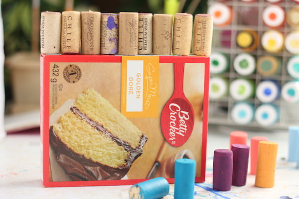 cake box with wine corks lined up on long side