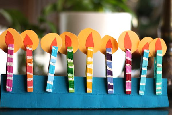 clothespin menorah with paper flames on table