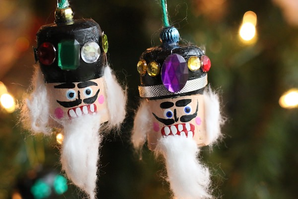 champagne cork nutcrackers heads ornaments on Christmas tree