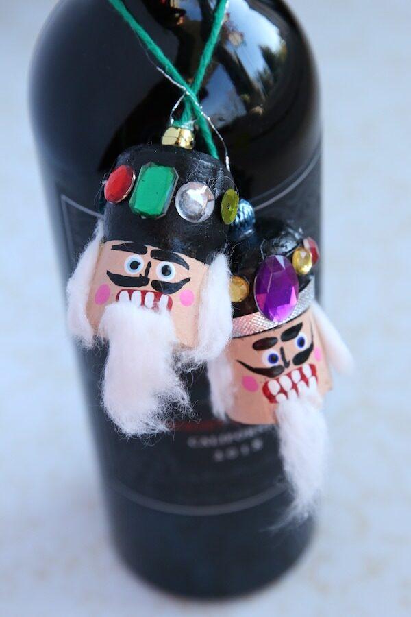 nutcracker Christmas ornament around neck of bottle of wine