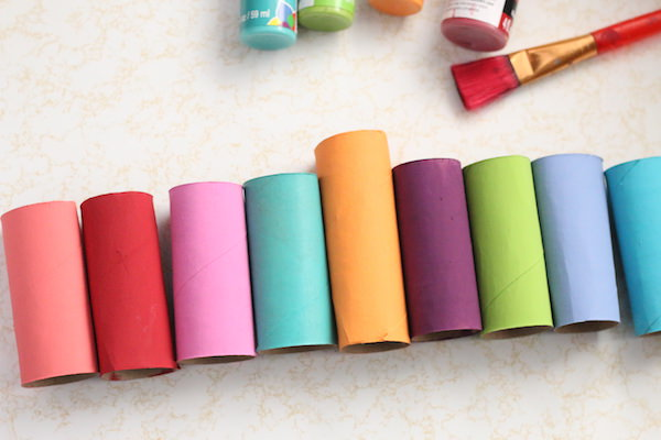 painted cardboard rolls lined up in a row