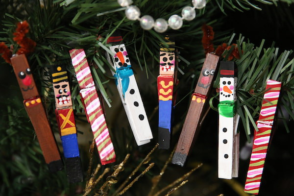 homemade clothespin ornaments hung in a row on christmas tree
