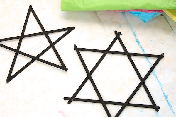 stir stick stars painted black