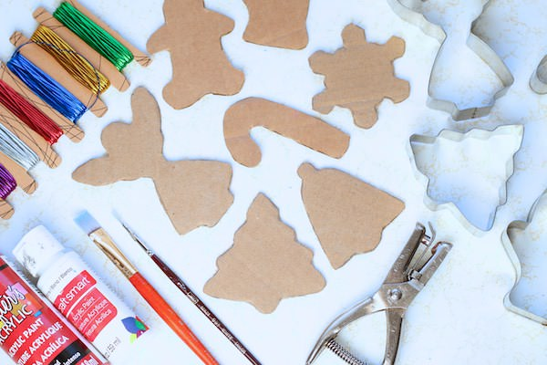 christmas cookie cutters, cardboard shapes, red and white paint,