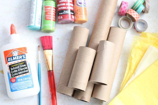 cardboard rolls, paint, glue, paintbrushes, washi tape, tissue paper