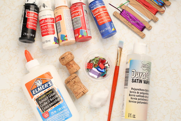 corks, paint, glue, gems, cotton ball