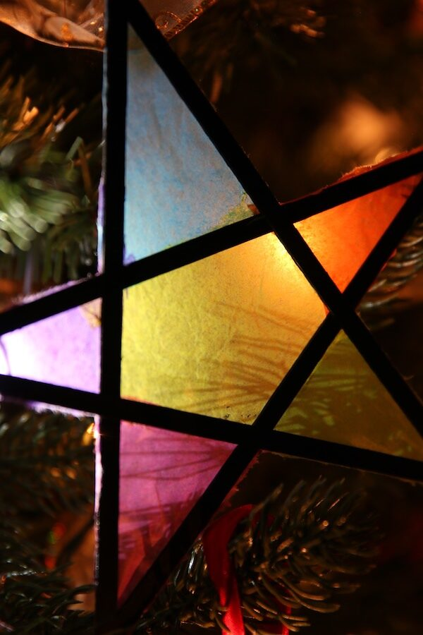 tissue paper stained glass star on christmas tree