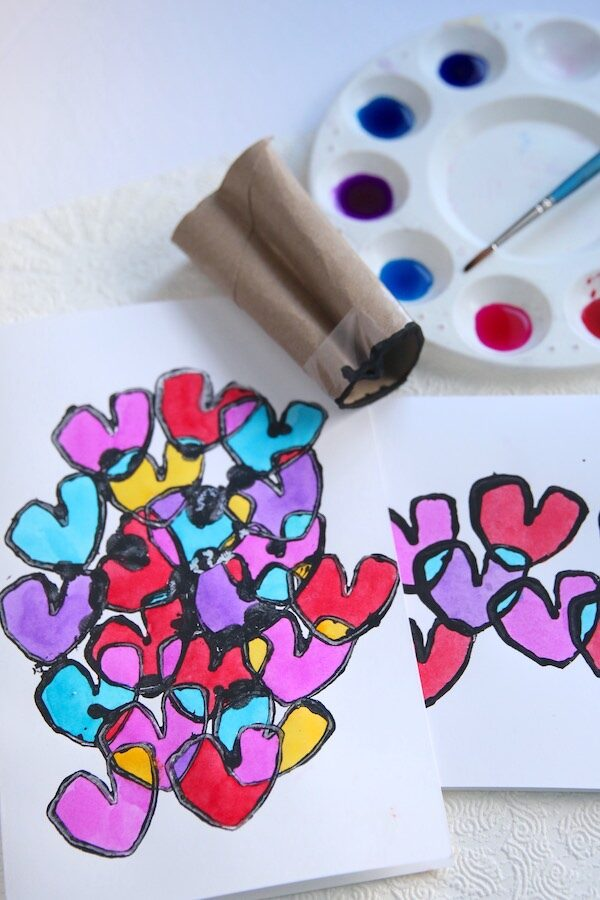 watercolour paints, yardstick, toilet paper roll shaped into heart