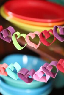 toilet paper roll heart bunting in front of colourful fiesta ware