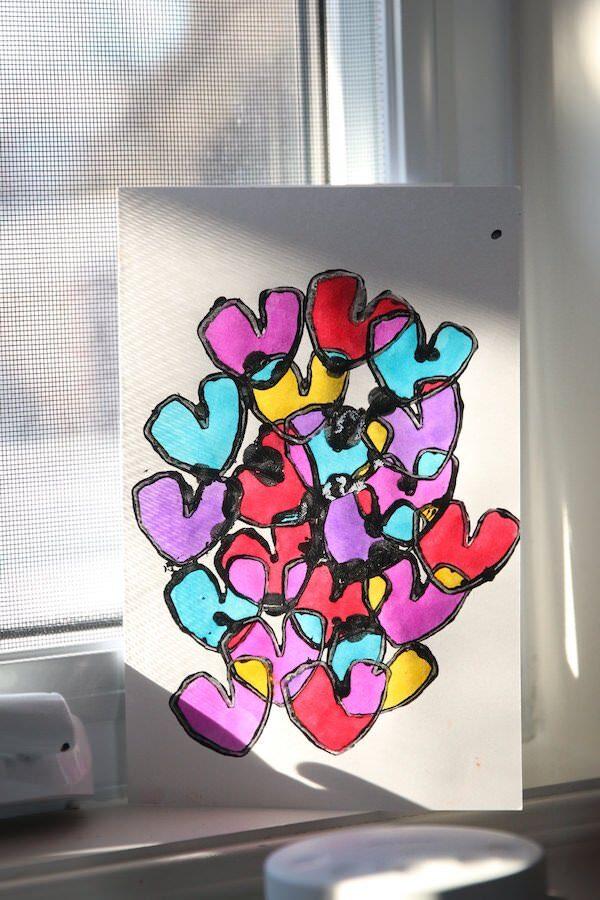 colourful vertical tp heart card on sunny windowsill