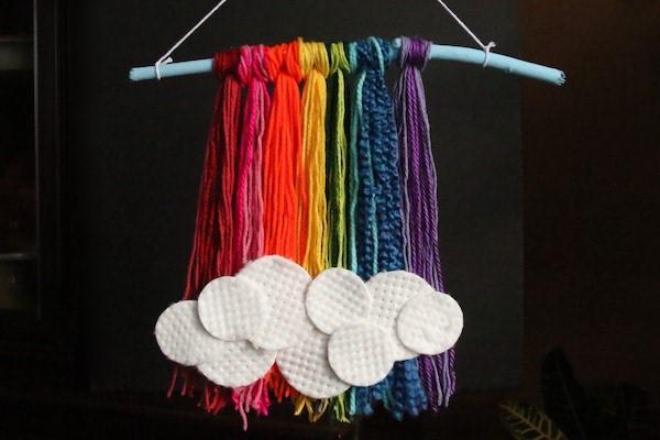 Rainbow yarn and stick wall art
