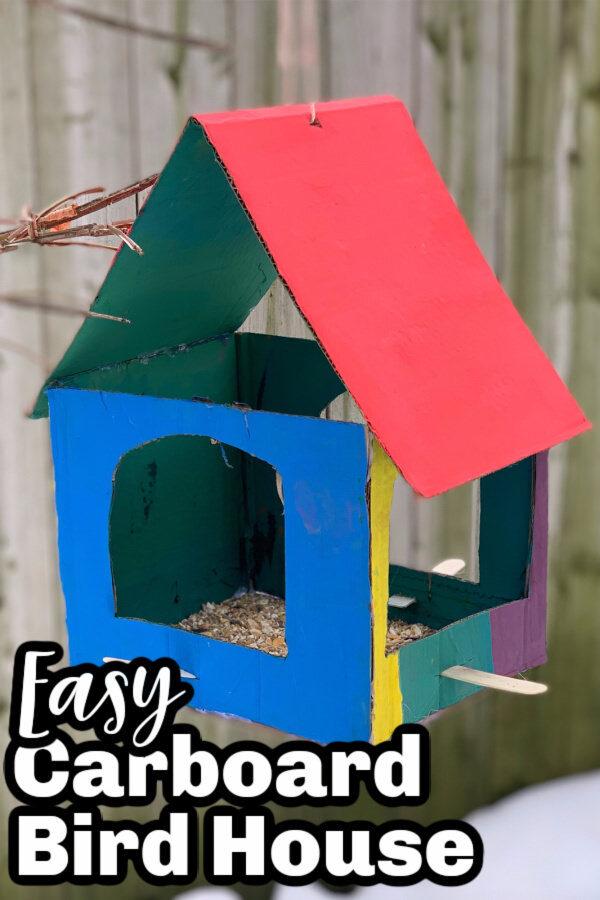 Painted cardboard bird house craft