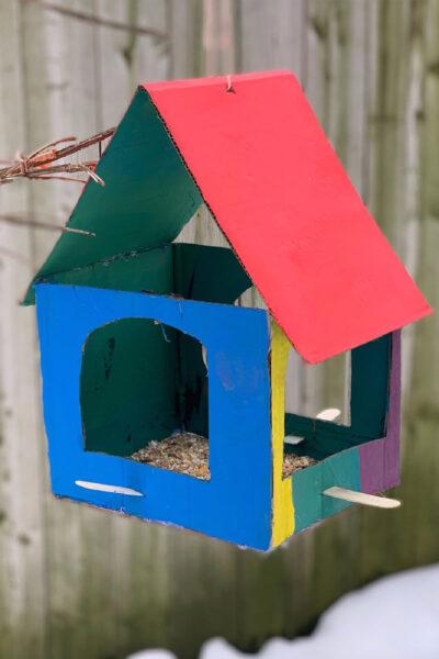 painted cardboard bird feeder feature img